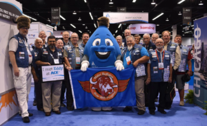 group standing around AWWA water drop mascot and water buffalos banner